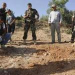 Lebanese soldiers inspected a site hit by a rocket, which residents said was recently fired from Syria.